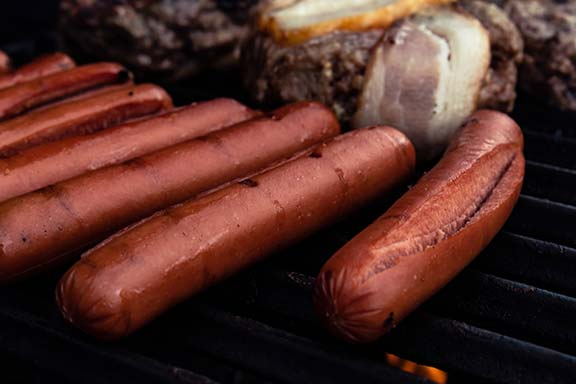 Hot dog sausages on the BBQ