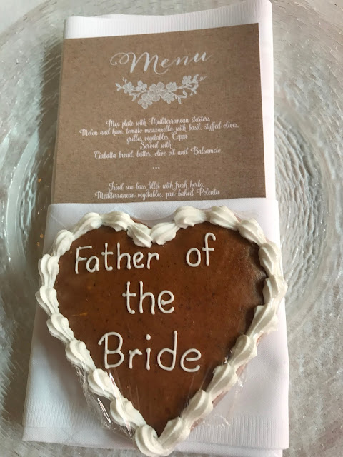 ginger bread heart and menu, Table decor with Hessians, wood, grey, brown, green, lilac, Wedding abroad, Mountain wedding lake-side at the Riessersee Hotel Resort Bavaria, Germany, Garmisch-Partenkirchen