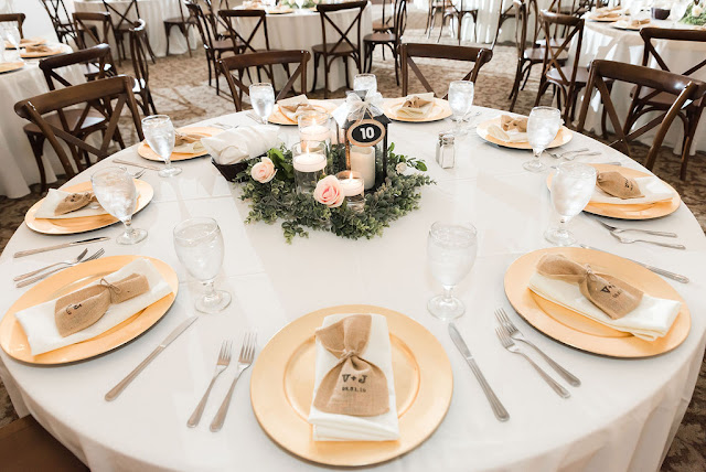 wedding table with gold chargers and favor bags
