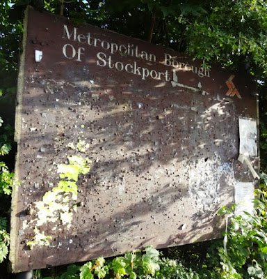An old Metropolitan Borough of Stockport community noticeboard on Adswood Road in Cheadle Hulme. This was still in place until last year when a car ploughed into it in a massive crash at the crossroads