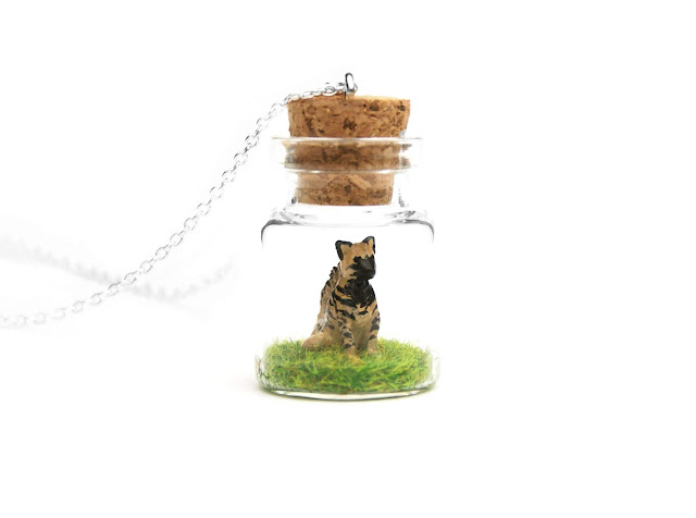 https://www.etsy.com/uk/listing/741630251/striped-hyena-miniature-necklace?ref=shop_home_active_11&frs=1