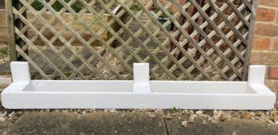 Small pallet planter painted white