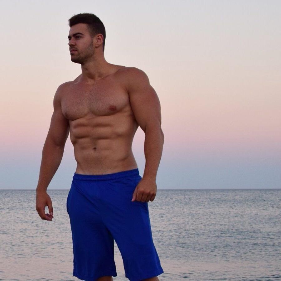huge-brazilian-muscle-man-beefcake-body-wide-shoulders-hairy-bare-chest-swole-pecs-abs-blue-shorts