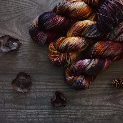dark variegated yarn on background of wood