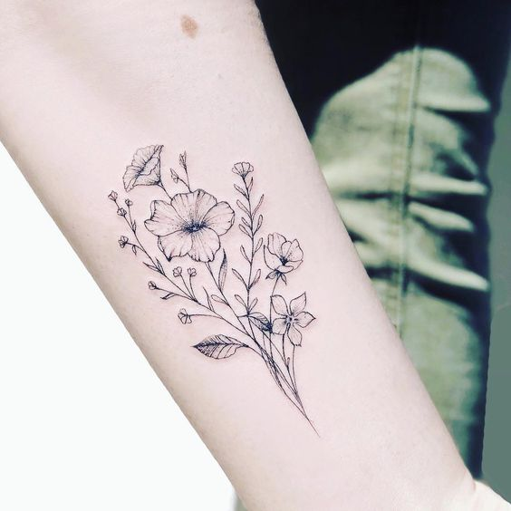 What is the meaning of the flower tattoo pattern?