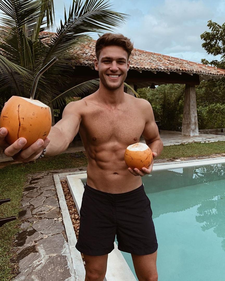 cute-shirtless-male-model-smiling-pool-drinks-boyfriend-material
