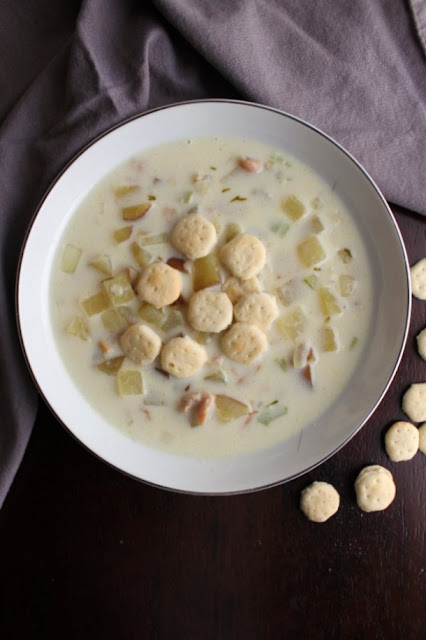 bowl of New England clam chowder with soup crackers