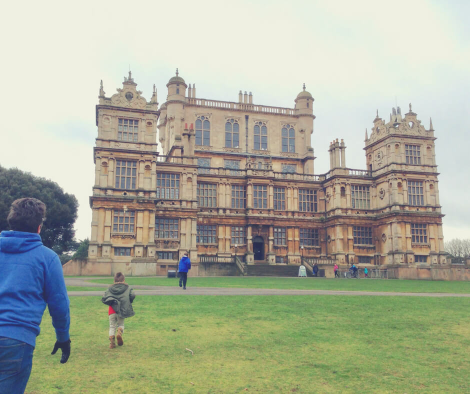 A family walks towards Wollaton Hall in Wollaton Park, Nottingham. This is how we spend our time together as a family.