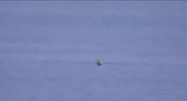 This is the UFO Sphere hovering above the water.