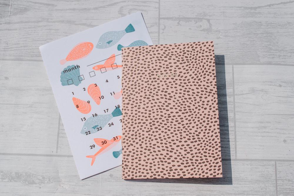A blank calendar card and a spotty notebook