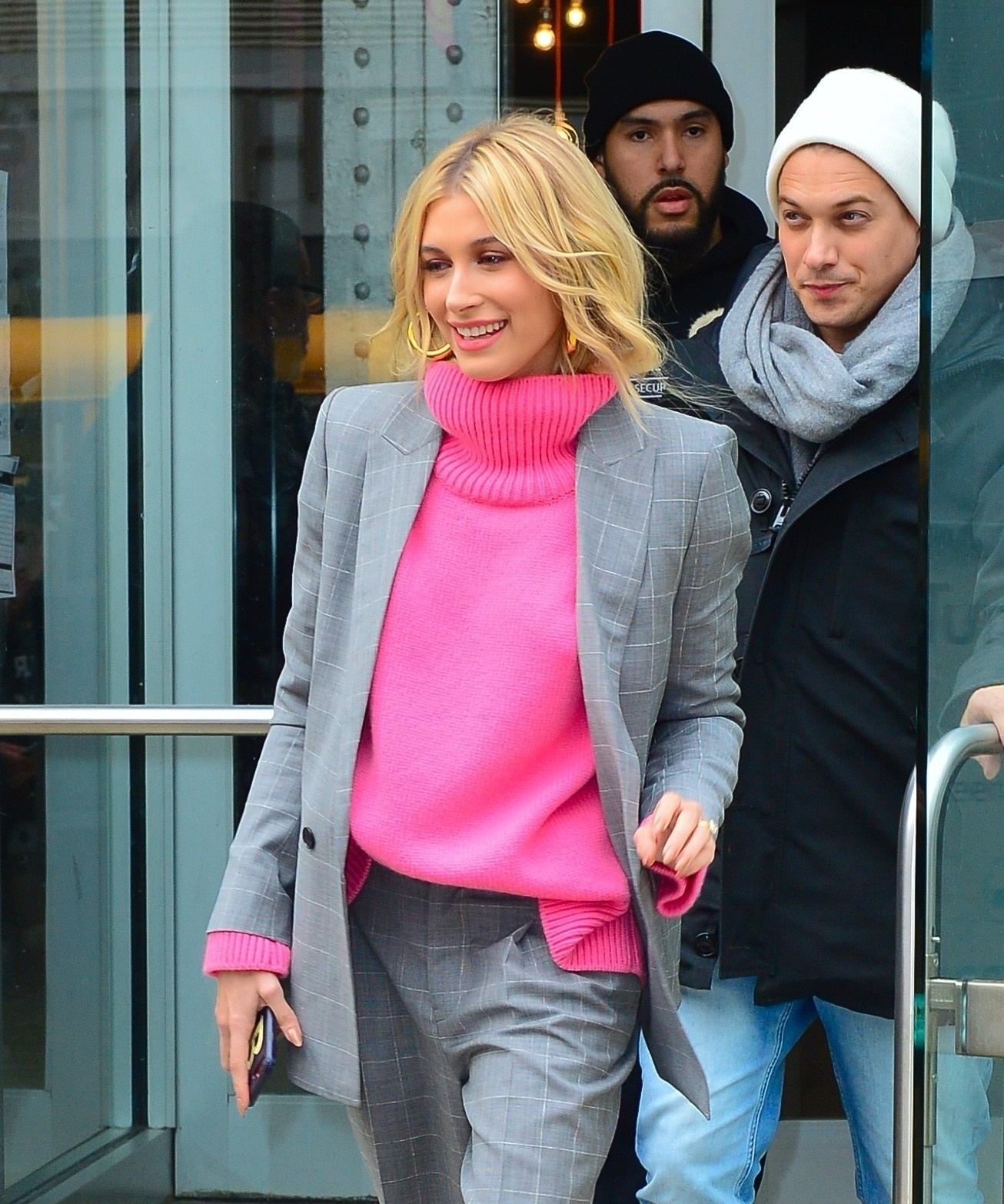 Hailey Baldwin - Strikes a pose in hot pink turtleneck under grey suit out in NYC February 11, 2019