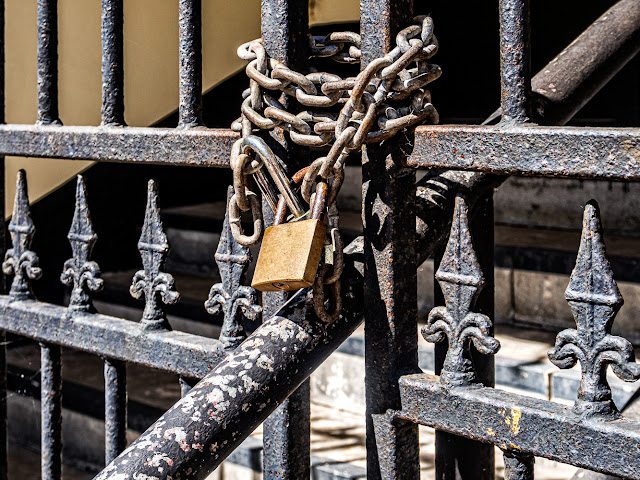 Photo of a locked metal gate on an empty building in Maryport