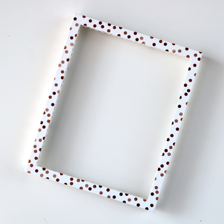 Learn how to decorate a plain frame with copper polka dots in this easy diy.