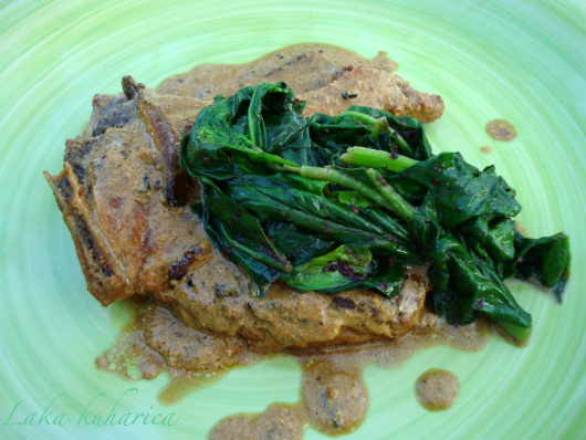 Pork chops with cider and spinach by Laka kuharica: chops smothered in creamy sauce and topped with spinach.