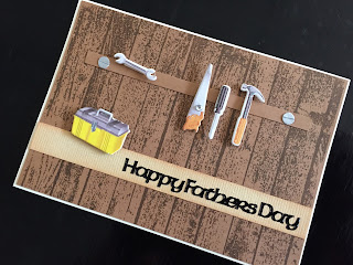 Hand made Fathers Day card with stamped background and workshop tools