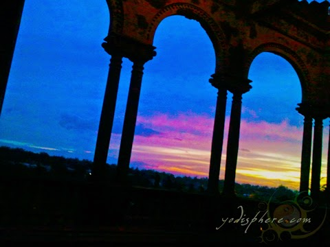hover_share Colorful sunset as viewed inside the large veranda windows inside The Ruins