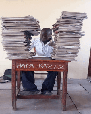 A teacher in staffroom marking. PHOTO | Courtesy