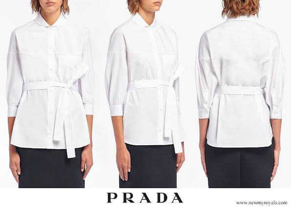 Princess Charlene wore a new white poplin tie-waist shirt from Prada