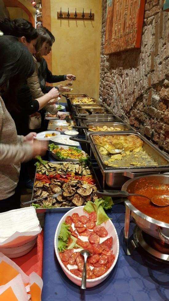 Spritz bar buffet of food for aperitivo in Navigli Milan