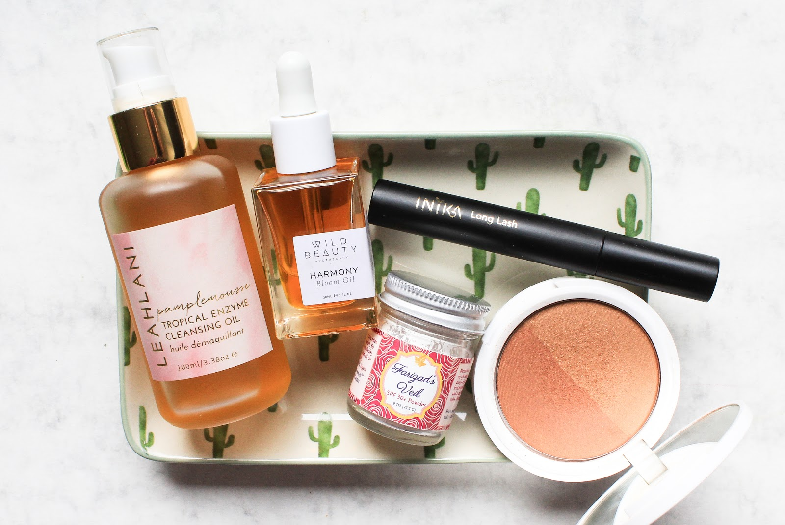 Current Natural and Organic Beauty Favourites. Leahlani Pamplemousse, Earthwise Beauty Farizad's Veil, Wild Beauty Apothecary Harmony Bloom Oil, Inika Long Lash mascara, Ere Perez Rice Powder Bronzer in Tulum