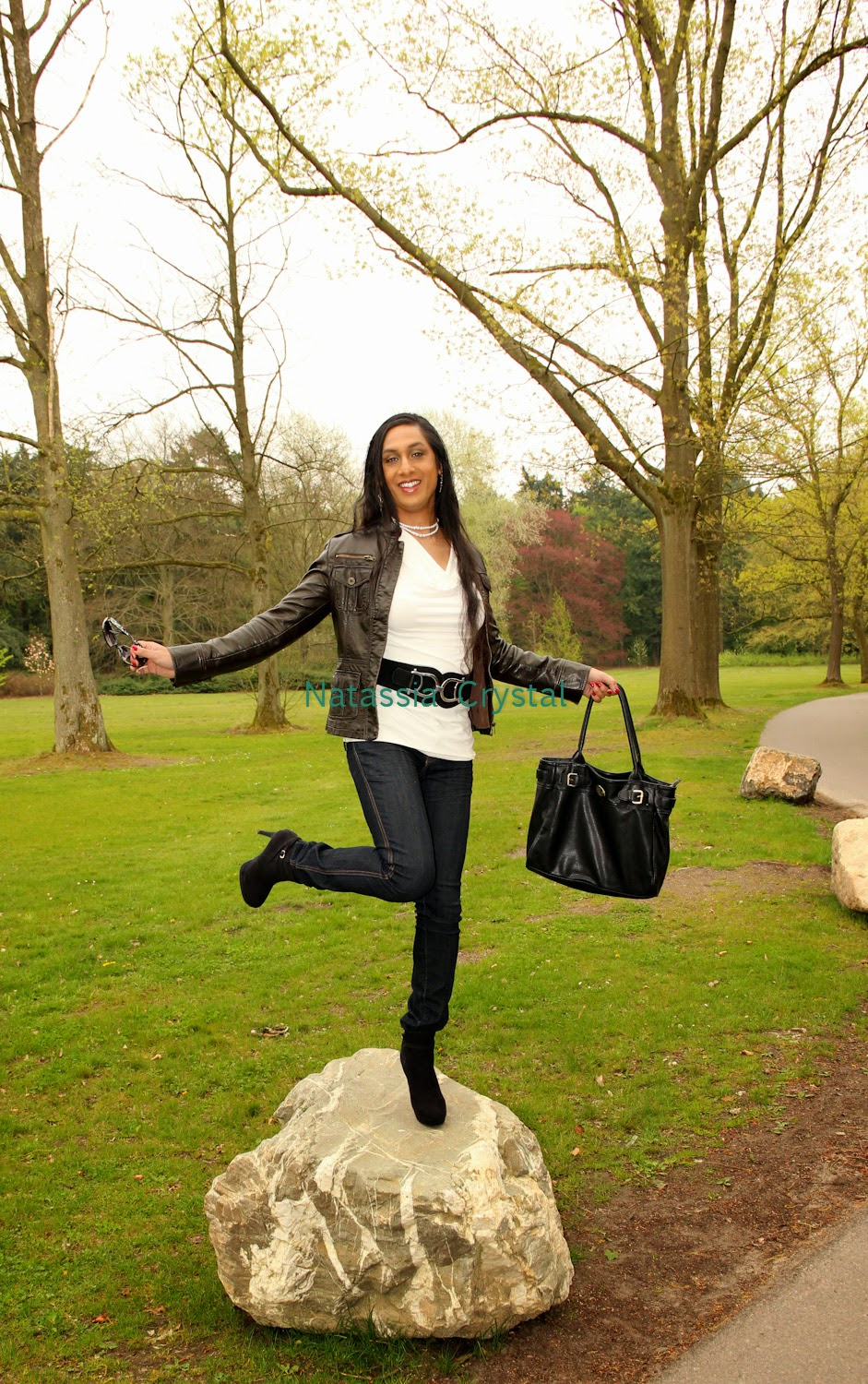 Natassia balancing on a rock in high heels