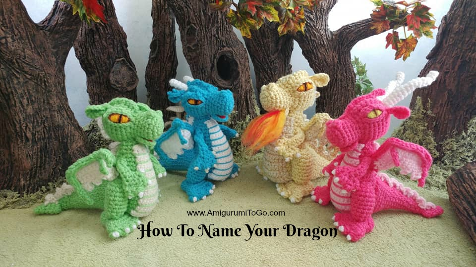colorful crochet dragons with trees in the background