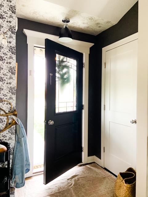 dark warm gray entry with black door