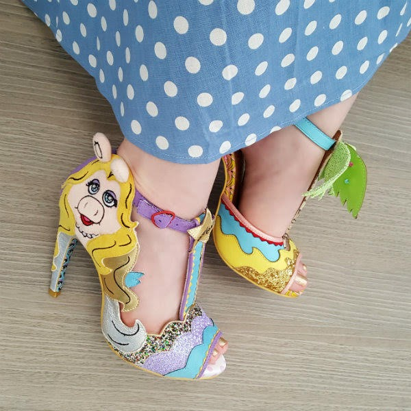 polka dot dress and foot wearing Miss Piggy glitter shoe