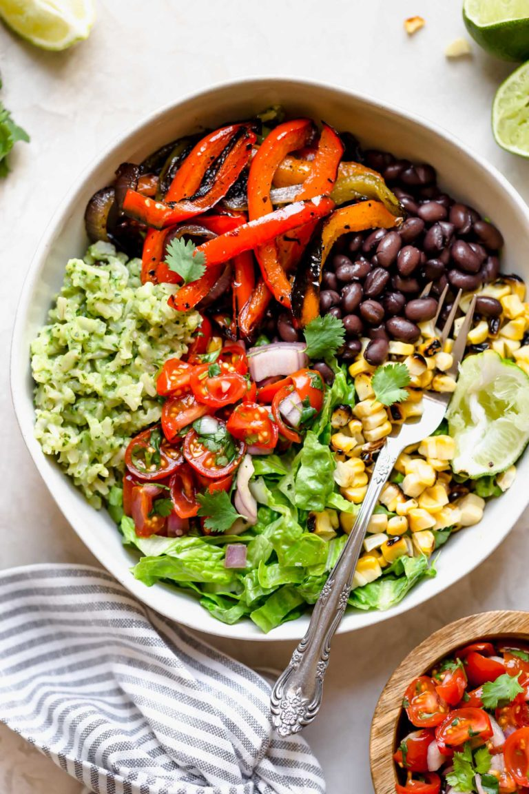 move over chipotle, these easy & healthy vegetarian black bean burrito bowls with green rice are loaded with flavor! grilled peppers, onions & sweet corn get paired with black beans, creamy avocado green rice in my vegan mexican rice bowl recipe. wholesome, plant-based, naturally vegan & gluten-free, & meal prep-friendly!