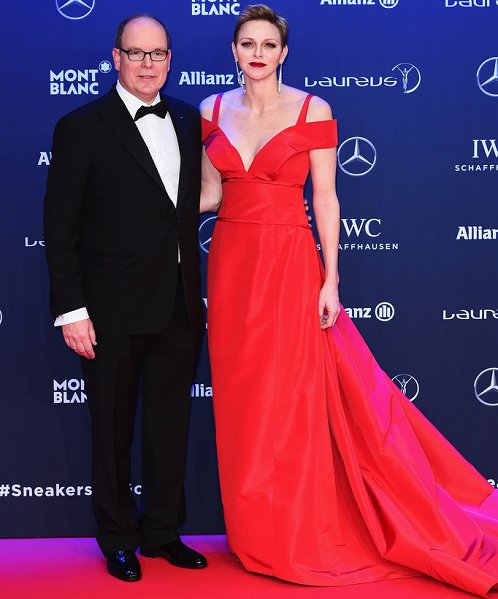 Princess Charlene wear red Carolina Herrera ball gown