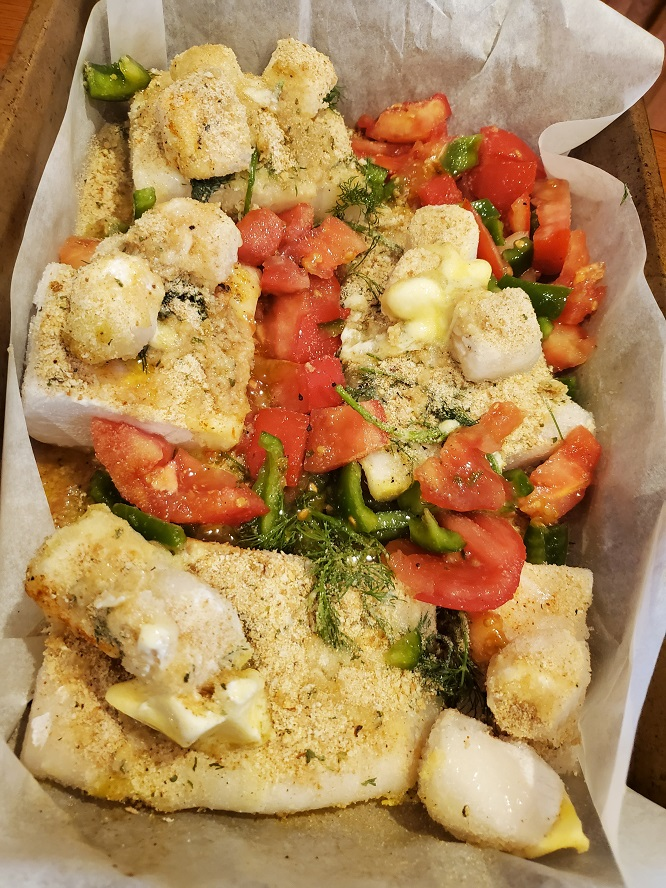 this is haddock fillets with tomato and peppers bake with breadcrumbs on top