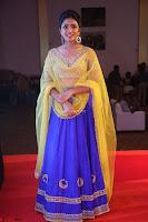 Actress Eesha in Yellow Choli Blue Ghagra at Darshakudu music launch 059.JPG