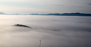 One tiny hut on an island above the fog