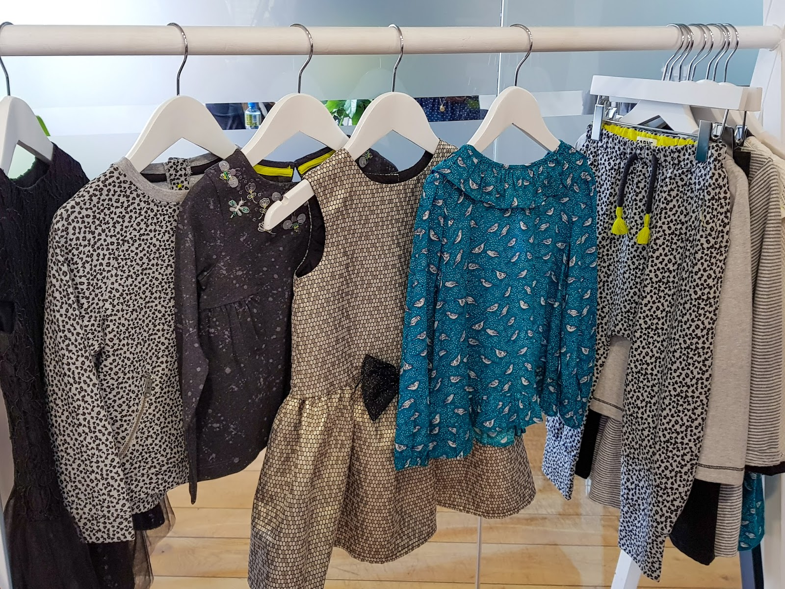 A hanging rail with a selection of tops and dresses