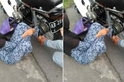 Hati-Hati Naik Motor Pakai Gamis, Wanita Ini Terjatuh karena Gamisnya Nyangkut di Rantai Motor