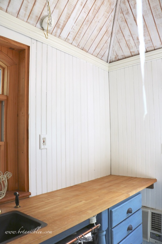 DIY new shelves in the garden shed call for freshly painted white wall