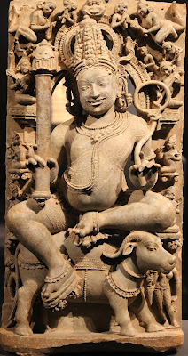Yama, th Hindu God of Death, holding the pasha (noose) in his left hand.