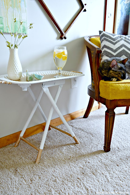 Thrift Store Decor: How to DIY a tray and a stool into a gorgeous white and gold accent table - One Mile Home Style
