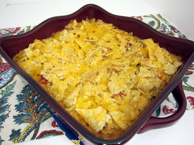 Fiesta Chicken Casserole - chicken, rice, chicken soup, Rotel, cheese and tortilla chips - Quick Mexican recipe that is ready in 30 minutes!! SOOO good! Use mild Rotel if you are worried about the heat. Everyone licked their plates clean!