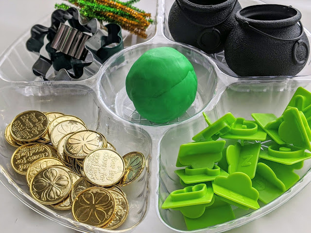 plastic gold coins, shamrock cookie cutters, cauldron for St. Patrick's Day play dough tray