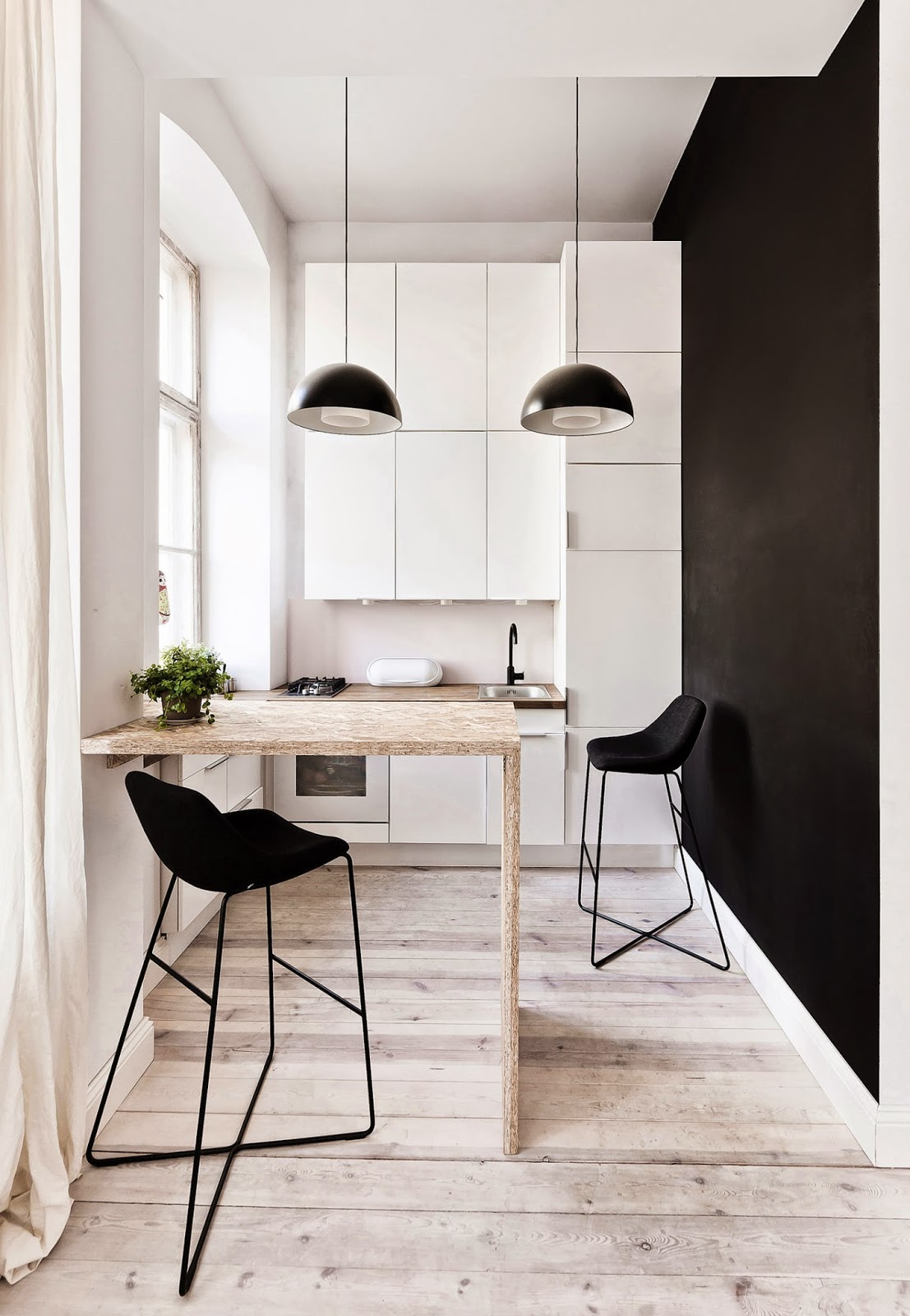 narrow kitchen island: white narrow kitchen with black wall