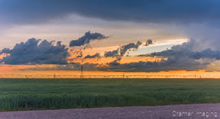 Cramer Imaging's fine art nature photograph of sunset and clouds after a storm in a farm field in Pocatello, Idaho