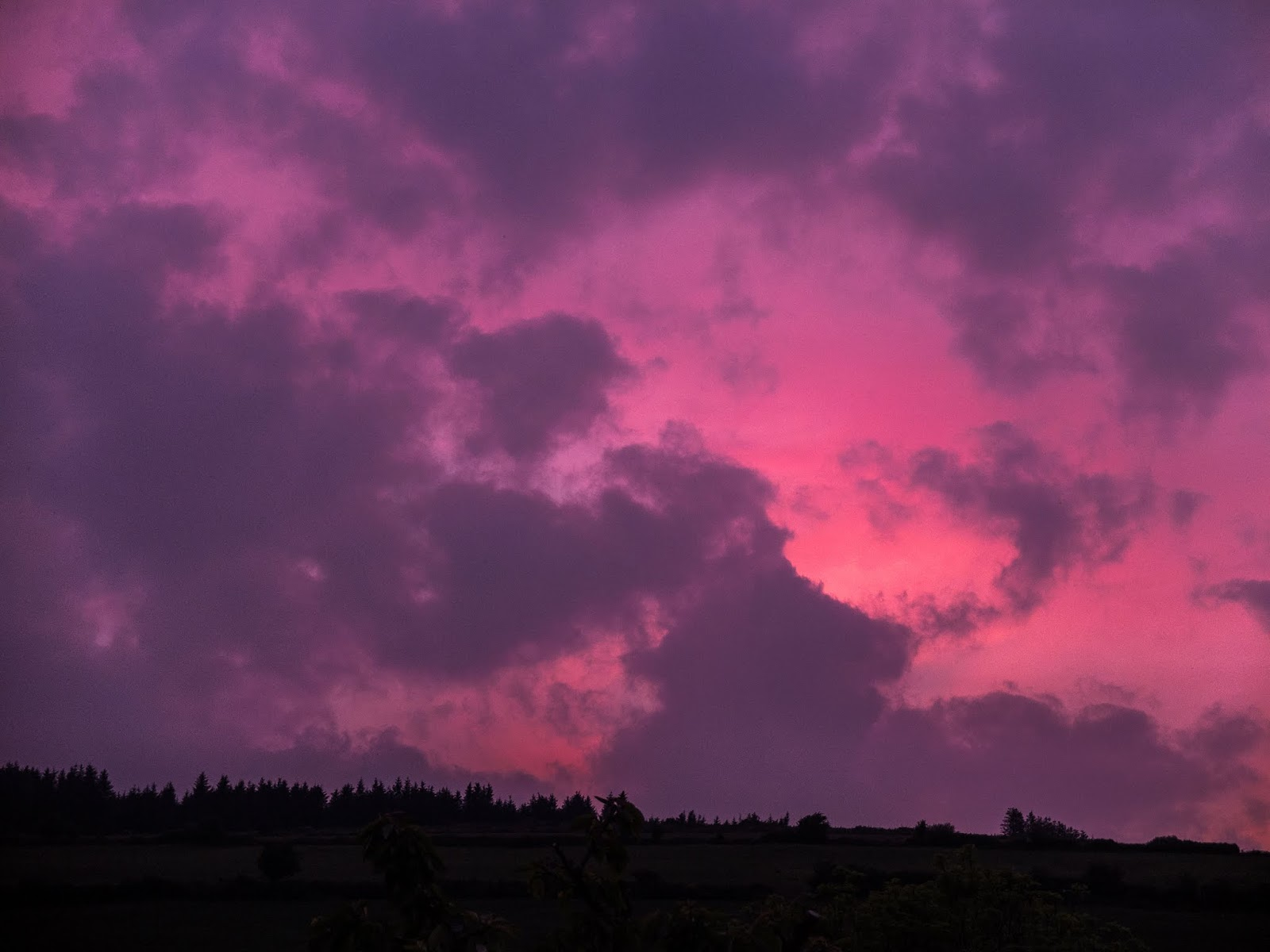 Purple and pink cloud sunset over a mountain in North Cork, Ireland.