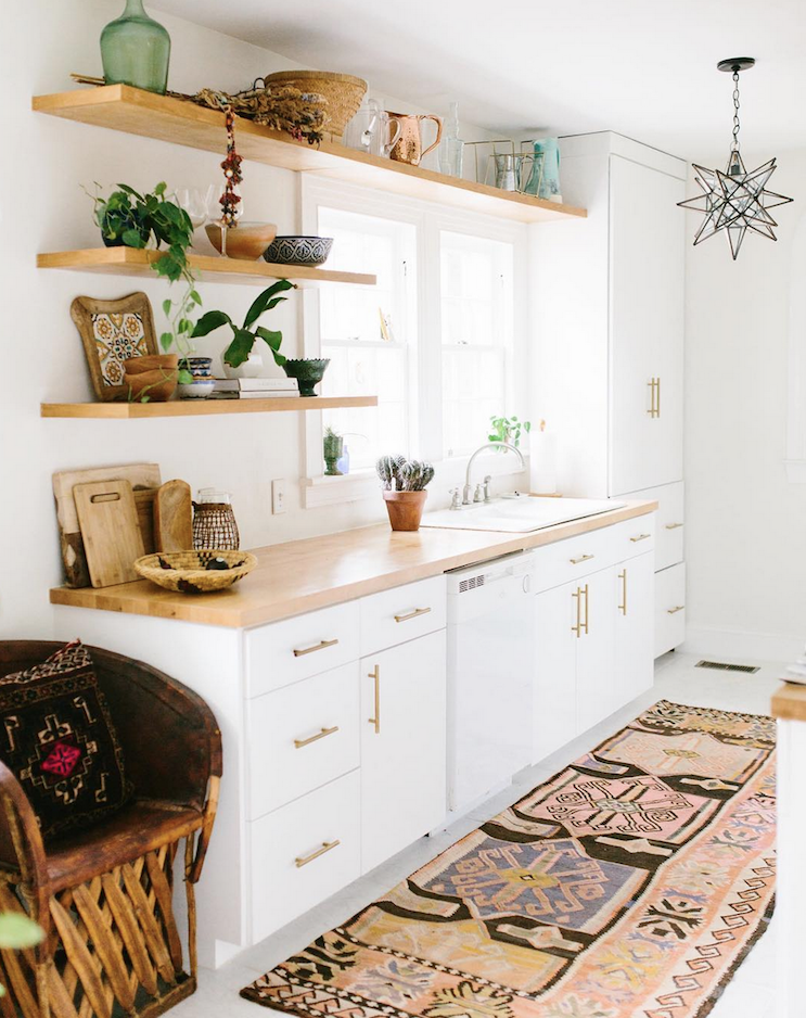 bohemian kitchen, oriental rug,goldhandles on kitchen cabinet