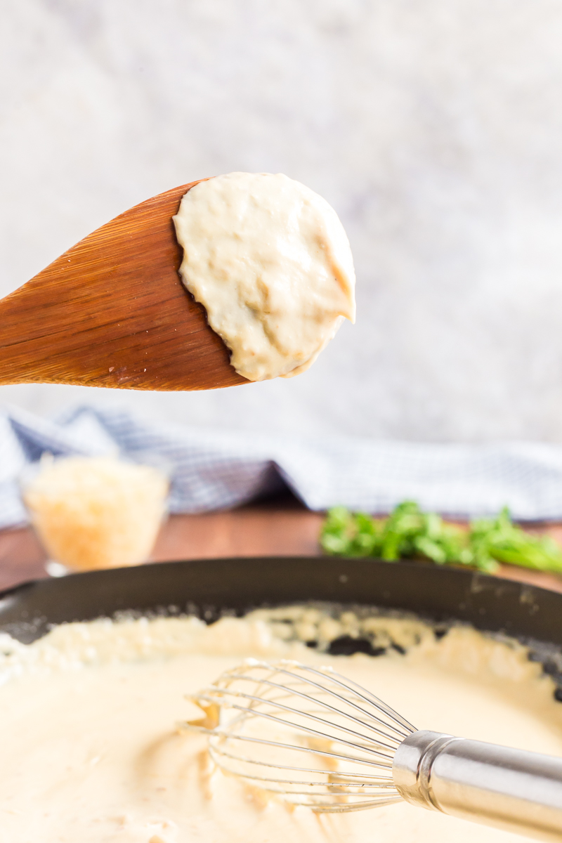 This creamy keto Alfredo Sauce is very low-carb and gluten-free. Loaded with garlic, Parmesan cheese, and just a touch of nutmeg. #glutenfree #lowcarb #keto #glutenfree #parmesan #cream #sauce #Italian #recipe #olivegarden #easy | bobbiskozykitchen.com
