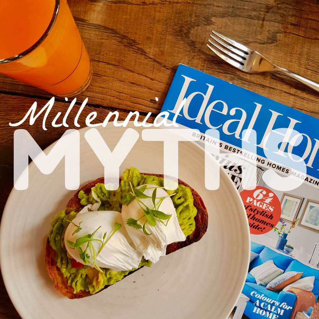 plate of avocado on toast with poached eggs sitting on top of a property magazine a glass of orange juice to one side