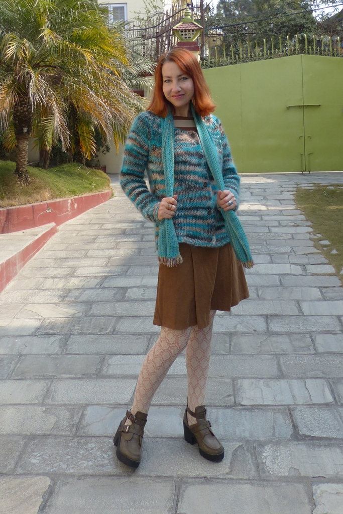 Corduroy skirt, stripy top and stripy knitted cardigan