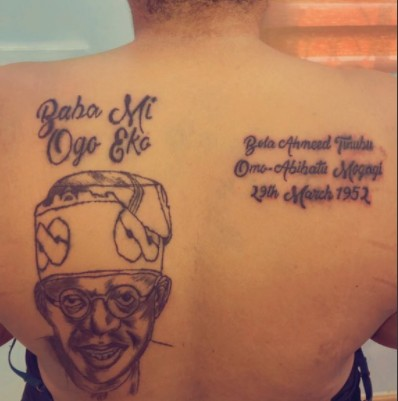 Lady Tattoos Bola Tinubu's face on her back (Pictures)
