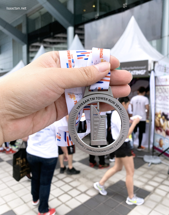Yayasan TM Tower Run 2019 finisher medal