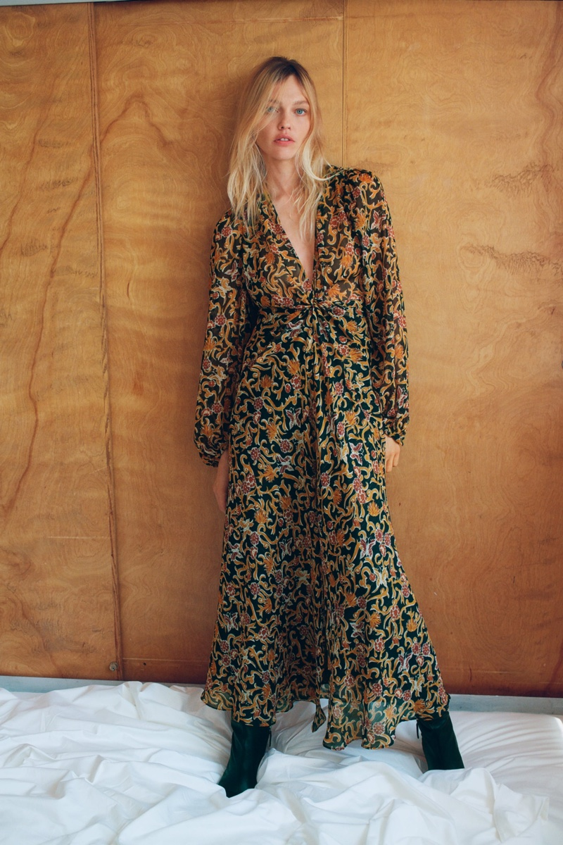 Sasha Pivovarova poses in Zara long sleeve print dress.